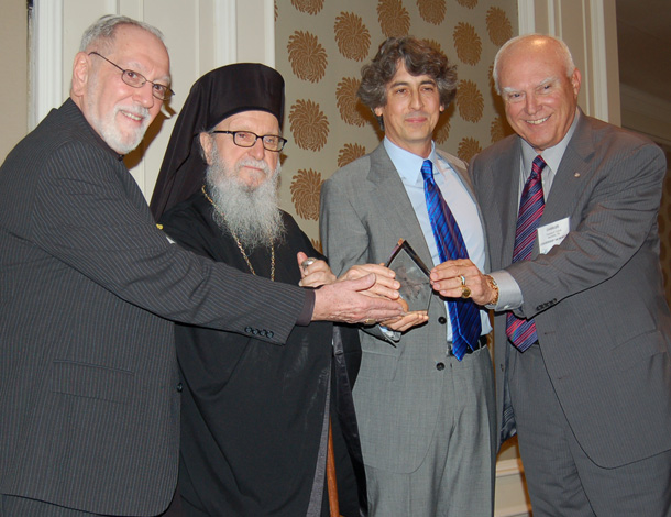 Archbishop Demetrios and Charles H. Cotros, Chairman of L100, joined by Fr. Eugene Pappas, far left, present Archbishop Iakovos Leadership 100 Award for Excellence to Alexander Payne, second from right, Photo: ETA PRESS