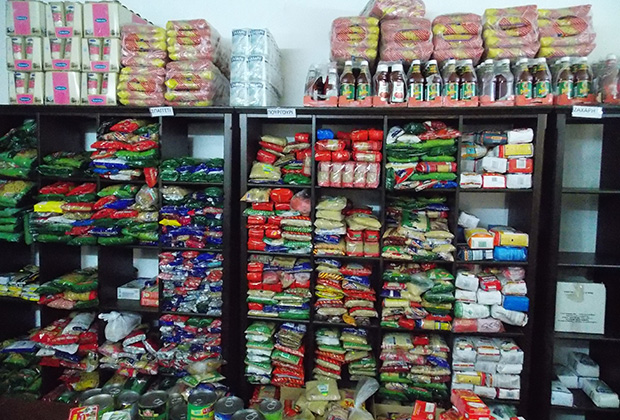 Stacks of pasta and rice line the shelves at the Aradippou food bank