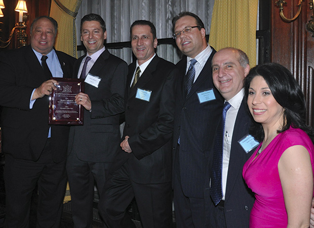 At the Hellenic American Bankers Association event: John Catsimatidis, Brent Callinicos holdind the Executive of the Year Award, Costas Kellas, President of HABA, Harry Prassakos, Manny Caravanos, Alexis Christoforous, Mistress of Ceremonies
