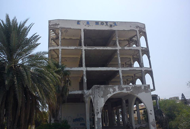 An abandoned and decaying hotel sits on the waterfront in Larnaca, Cyprus