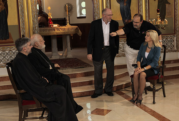 Senior Producer Nicholas J. Furris directs host Staci Spanos with Metropolitan Methodios of Boston, seared left background, and Rev. Dr. Demetrios Tonias, seated, left foreground and special consultant for the series, Dr. Anton Vrame, standing