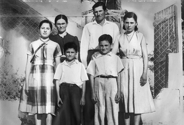 Photo of George with his siblings and parents in Vassara Greece (1956) before they immigrated to the United States. Back row from left, Helen, Areti, Panos and Pota Sakellaris. Front, Arthur and George Sakellaris