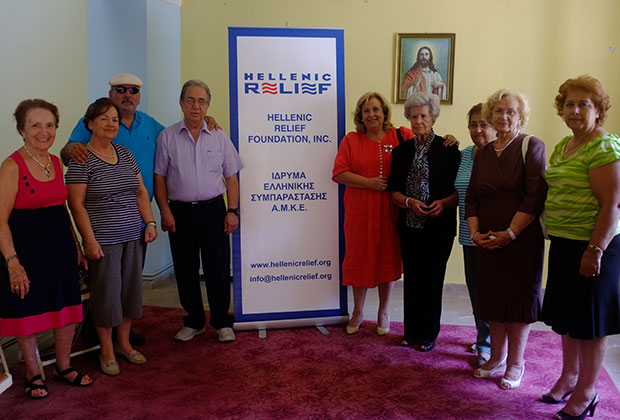 Hellenic Relief Board of Directors members Tassos Philippakos and Stelios Taketzis with head volunteer Maria Siourdi and ladies of the Christian Association of Women in Gytheio