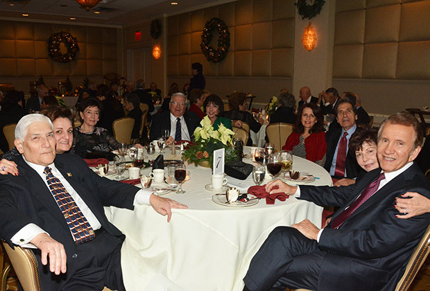 From right, Peter Mesologites and his wife Kathy with friends and the Ted & Christina Malgarinos couple (left) at last year's Christmas event