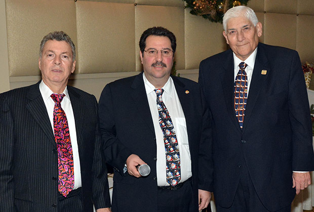 Paul Macropoulos, John Levas and Ted Malgarinos at last year's Christmas gala