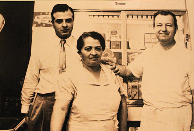 """My father, Michael Colombos with my grandparents, Nicholas and Evangelia Colombos, at the family deli on East 72nd"""