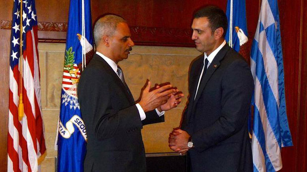 Greece's Minister of Public Order and Citizen Protection Vassilis Kikilias (right) with US Attorney General Eric Holder