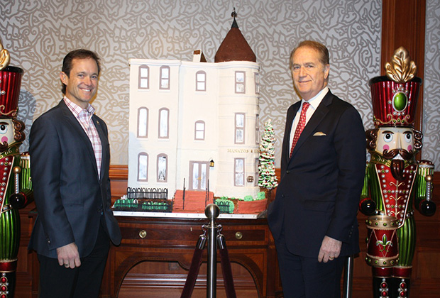 Mike and Andy Manatos with Ritz Carlton's four-foot high gingerbread replica of the office building of their Washington public policy company (bottom)
