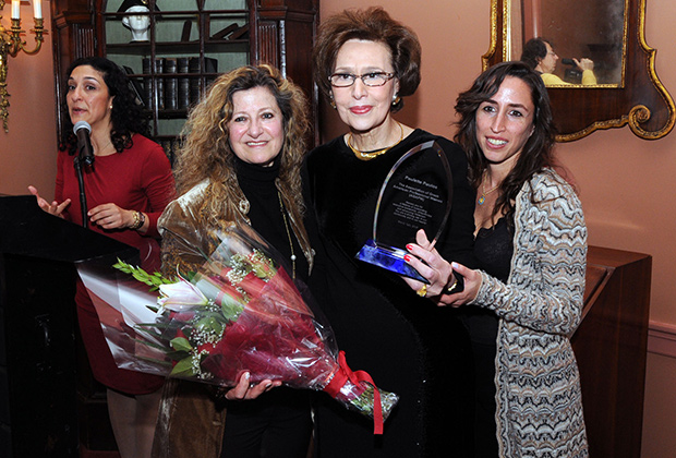 "Olga Alexakos (left) and Dr. Aphrodite Navab, present ""Greek American Woman of the Year' Award to Paulette Poulos. On far left is Anthoula Katsimatides"