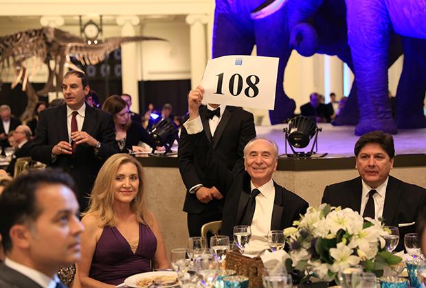 Ted Parros, Ethel Parthenis, Peter Parthenis, and Paul Karras during the live auction.