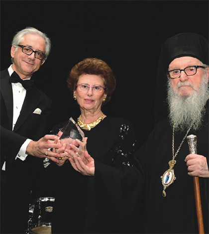 George S. Tsandikos, Leadership 100 Chairman, left, and Archbishop Demetrios present the Archbishop Iakovos Leadership 100 Award for Excellence to Angeliki (Lila) Lalaounis in honor of her late husband, Ilias I. Lalaounis.