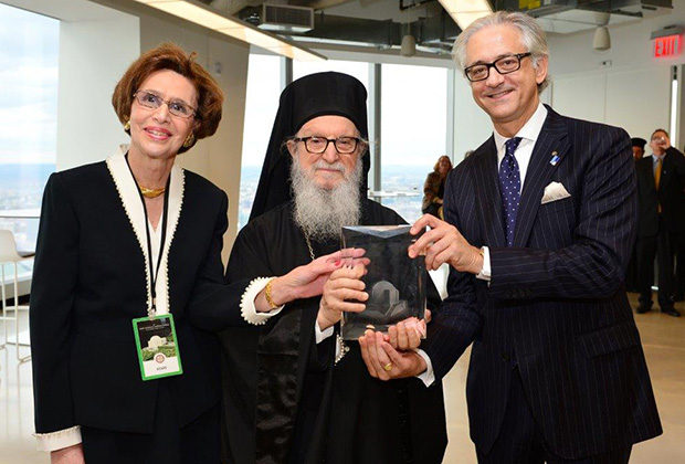Saint Nicholas crystal design replica presented by Archbishop Demetrios to George S. Tsandikos, Leadership 100 Chairman and Paulette Poulos, Executive Director