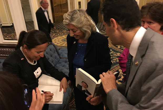 Congresswoman Dina Titus and Congressman John Sarbanes getting their copies signed, at the AHEPA Congressional Banquet in Washington