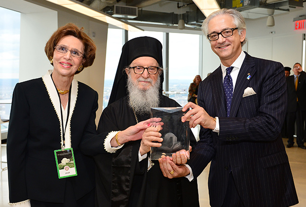 George S. Tsandikos and Paulette Poulos accept award of St. Nicholas Greek Orthodox National Shrine from His Eminence Archbishop Demetrios in acknowledgement of Leadership 100 support in October of 2014.