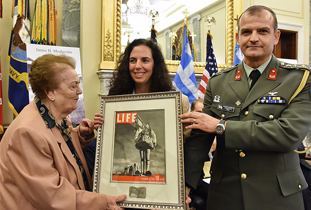 Themis Douratsou-Paleologou and Sophia Paleologou accept the 2015 Greatest Generation Award on behalf of General George Douratsos from Greek Defense Attaché Panagiotis Kavidopoulos, PHOTO BY: BILL PETROS