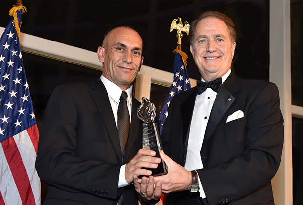 Khalil al-Dakhi receives the 2015 Oxi Day Award from Washington Oxi Day Foundation Founder and President Andy Manatos, PHOTO BY: BILL PETROS