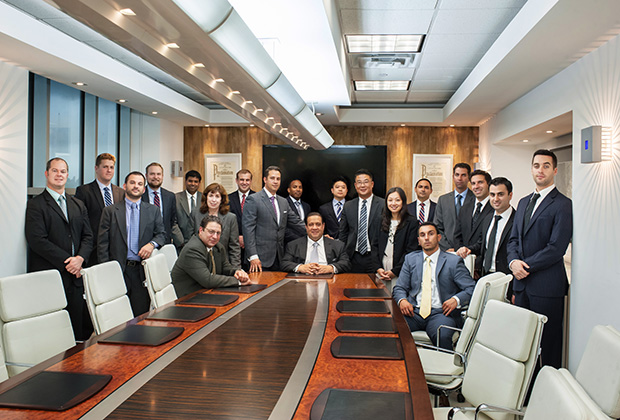 From left, the firm's Attorneys Albert Matuza, Matthew Beckwith, Luigi Brandimarte, Scott Laird, James Benintendi, Joanne Ciaramella, Shibu Jacob, Christopher DelCioppio, Elias Fillas, Lamont Rodgers, Tonino Sacco, William Sung, Ying Hua Huang, Si Aydiner, Andrew Wiese, Sal Asaro, Brad Levin, Nissim Abaev and David Roer