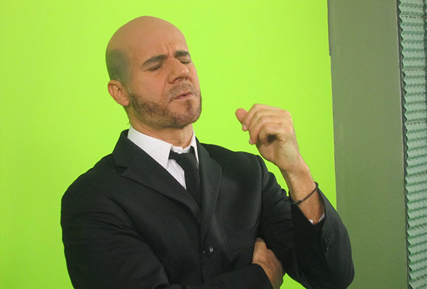 Giorgos Mitsikostas as TV news anchor Konstantinos Bogdanos
