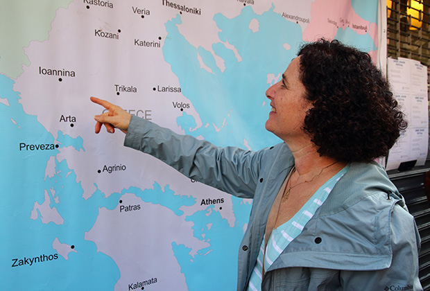Alyse Elias Matsil pointing at Ionannina on the map of Greece