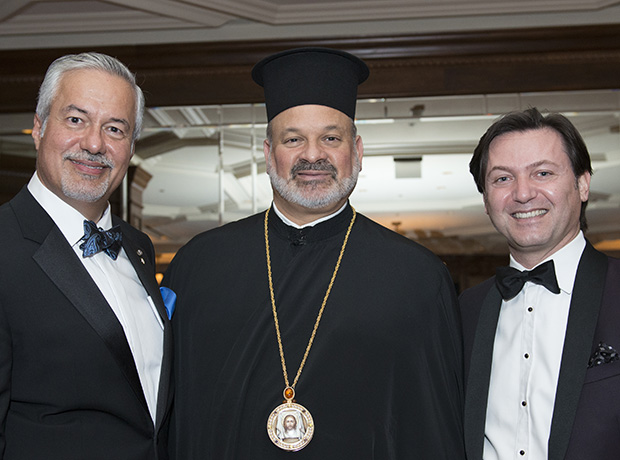 John Manos, His Grace Bishop Demetrios of Mokissos, and Yanni Valsamas