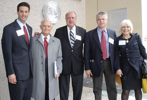(L-R) Congressman John Sarbanes of Maryland; Prof. Vassilios Makios, general director of Hellenic Technology Clusters Initiative; leading Greek American industrialist and philanthropist John G. Rangos; Prof. Charalambos Gogos, professor of Medicine at the University of Patras; and Ioanna-Annita Mavromichalis, representing the Greek Embassy in Washington, stand in front of the Rangos Building at Johns Hopkins University.