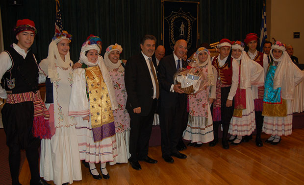 Michael Psaros and John Kontolios with members of the Chian Federation dancing troupe