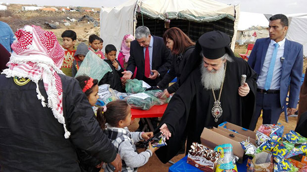 Patriarch Theophilos III visiting the camps and offering gifts