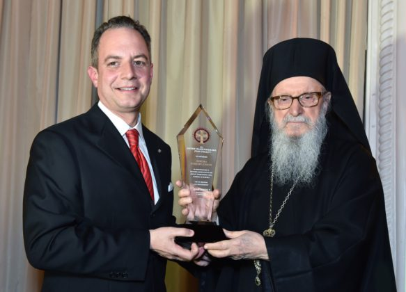 White House Chief of Staff Reince Priebus receives his Medal of St. Paul Award from Archbishop Demetrios