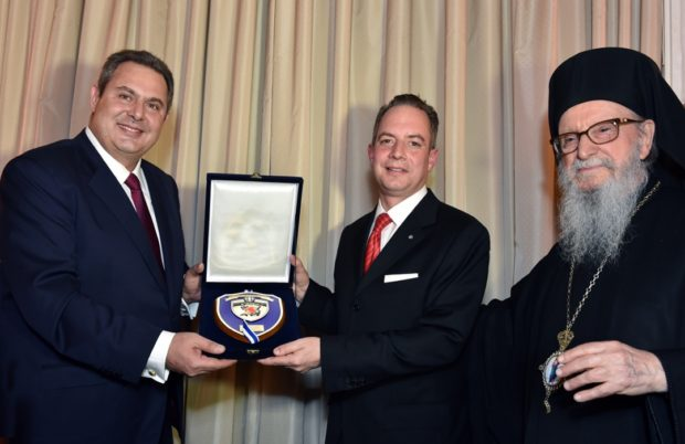Greek Minister of Defense Panos Kammenos presents Reince Preibus with a gift