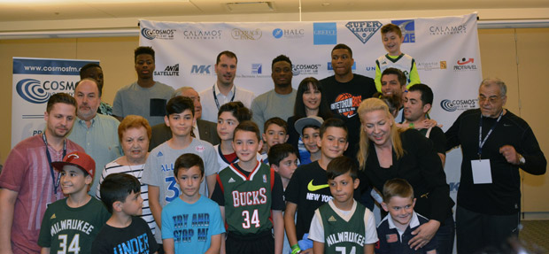 The Antetokounmpo brothers, Minister Kountoura, guests and children who took part in the basketball game. Photo ETA Press