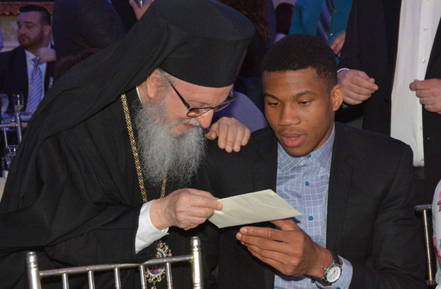 Arcbhishop Demetrios enjoying a personal moment with Giannis. Photo ETA Press