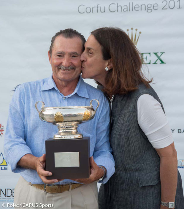 George Sakellaris with trophy is congratulated by his wife, Cathy.