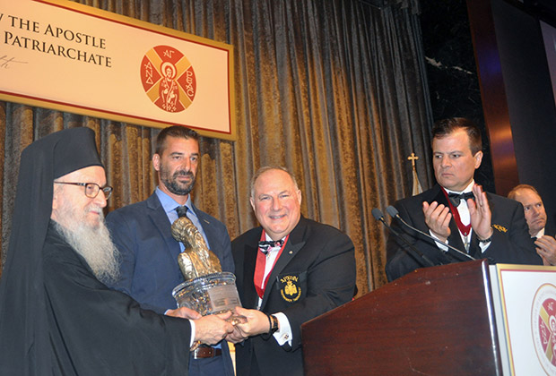 Archbishop Demetrios and Archons National Commander Anthony Limberakis present Efstratios Valiamos with the Athenagoras Humanitarian Award