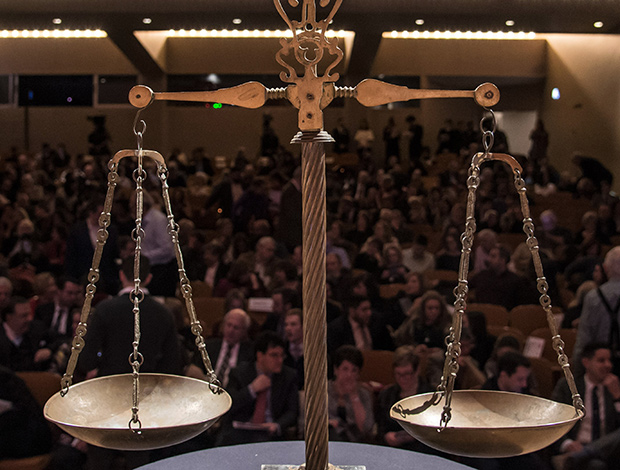The scales of justice before the citizen jury of audience members cast their votes at the NHM Trial of Megacles, Photo by Elios Photography©️2018