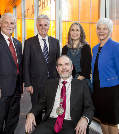 John P. Calamos, Sr., (left), University President Alan W. Cramb, and Lewis College of Human Sciences Dean Christine Hines (far right) pose with John & Mae Calamos Endowed Chair of Philosophy JD Trout, Ph.D., (seated) and his wife Janice Nadler (standing center)