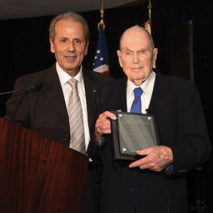Hon. Consul General of Cyprus Andreas Kyprianides presents Aris Anagnos with the Life-time Achievement Award