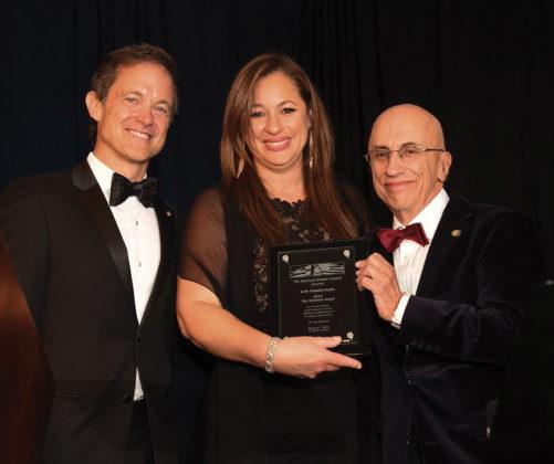Mike Manatos and Menas Kafatos award the Aristeion Award to Kelly Vlahakis-Hanks