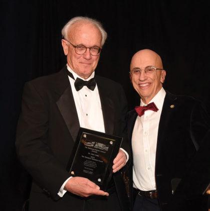AHC Chairman Menas Kafatos awards the Theodore Saloutos Award to Prof. John Camp