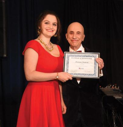 AHC Chairman Menas Kafatos awards the Dr. and Mrs. James Kallins Scholarship to Georgia Kouros