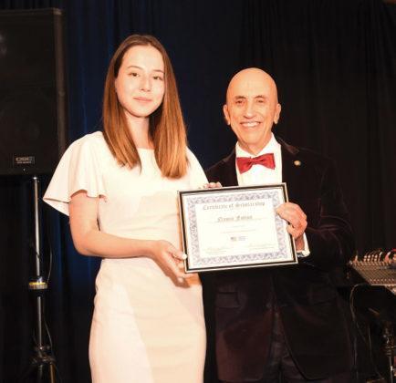 AHC Chairman Menas Kafatos awards the Van Vlahakis' Scholarship to Namie Fotion