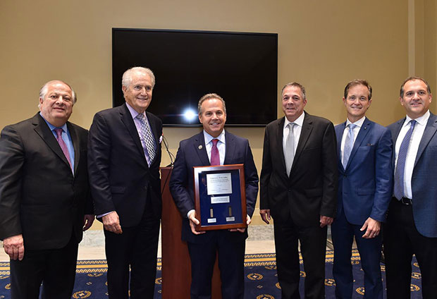 Author of the Cyprus Arms Embargo Bill, Congressman David Cicilline, is honored with (L to R) Philip Christopher, Andy Manatos, Lou Raptakis, Mike Manatos, Endy Zemenides, PHOTOS: BILL PETROS
