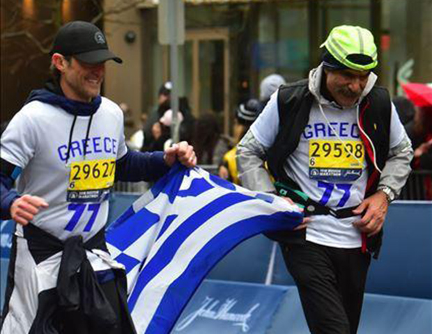 Jimmy and Mike crossing the Boston Marathon finish line in the same jersey worn by 1946 Boston Marathon champion Stylianos Kyriakides