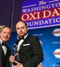 Oxi Courage Award recipient Vladimir Kara-Murza and presenter Michael Psaros