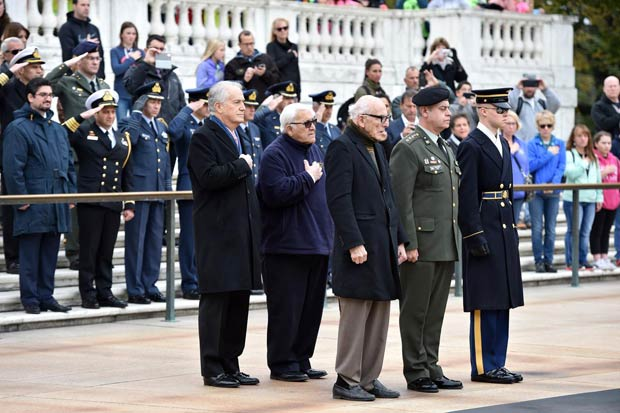 Laying a wreath at Arlington National Cemetary's Tomb of the Unknowns in tribute to those who lost their lives in WWII