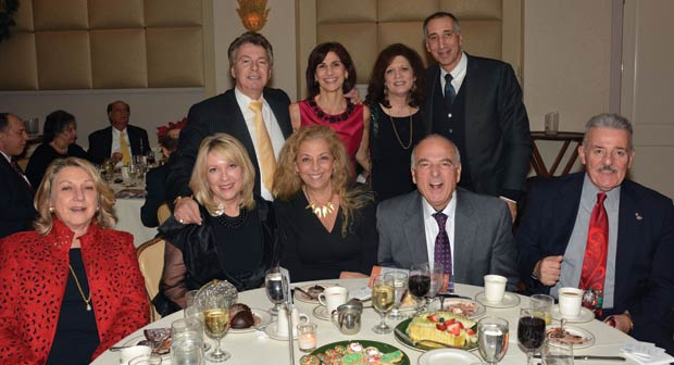 Paul Macropoulos, Penny Makris, Marie Kratsios, John Gionis, Esq. Sitting from left are, Evangelia Dushas, Bibbijoe Macropoulos, Drs. Anna & Michael Georgas, Tom Dushas, PHOTO: ETA PRESS