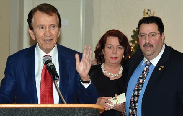 Peter Mesologites is doing the raffle with Evangelia Cyprus and Chapter President John Levas, PHOTO: ETA PRESS