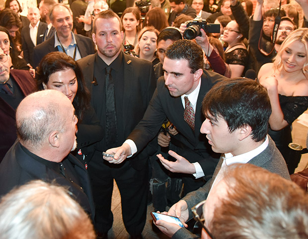 Billy Joel talks with reporters and with NEO's Markos Papadatos before the Long Island Hall of Fame ceremony. PHOTO: MIKE COLUCCI