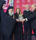Father Alex and Presbytera Xanthi Karloutsos receiving the Athenagoras Human Rights Award by Archbishop, Geron of America Demetrios and the Archons National Commander Anthony J. Limberakis. Metropolitan Emmanuel of France (1st from left) represented the Ecumenical Patriarch.