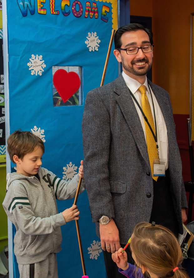 Mr. George is measured by a second grader using meter sticks. Photo: Sotiris Michalatos/TCS