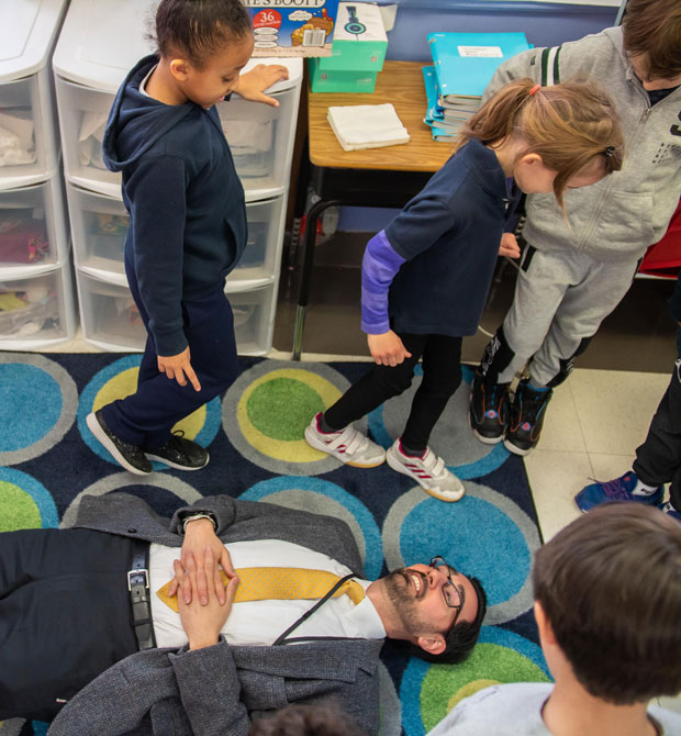Mr. George is measured by a second grader who paces the perimeter around him. Photo: Sotiris Michalatos/TCS